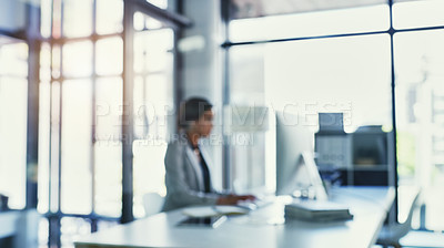 Buy stock photo Cropped shot of a focused young businesswoman working on a computer inside of the office