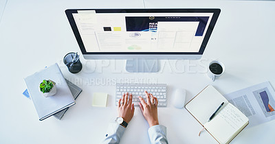 Buy stock photo High angle shot of an unrecognizable businesswoman working on a computer inside of the office