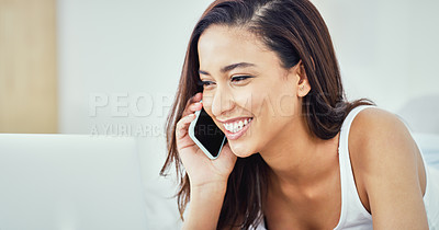 Buy stock photo Shot of an attractive young woman answering a phone call in bed at home