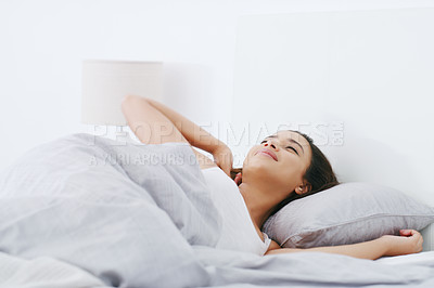 Buy stock photo Shot of an attractive young woman sleeping in bed in her bedroom