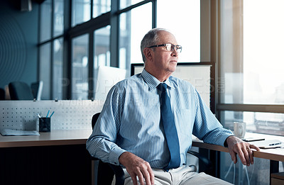 Buy stock photo Cropped shot of a mature businessman sitting in his office