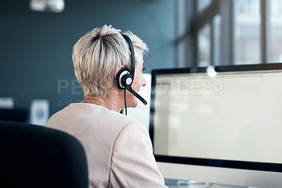 Buy stock photo Cropped shot of a mature woman working in a call centre