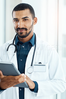 Buy stock photo Portrait of a young doctor using a digital tablet in a modern hospital