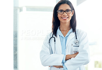 Buy stock photo Portrait of a confident young doctor working in a modern hospital