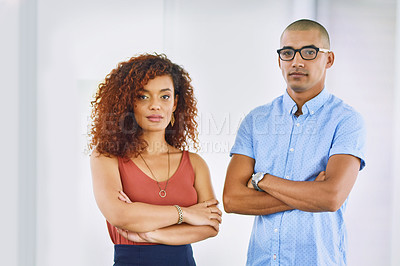 Buy stock photo Portrait of two young businesspeople standing in an office