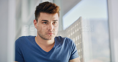 Buy stock photo Cropped shot of a handsome young man going through his morning routine in the bathroom at home