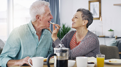 Buy stock photo Shot of a senior couple having breakfast together at home