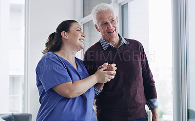 Buy stock photo Shot of a senior woman going for a walk with a young nurse
