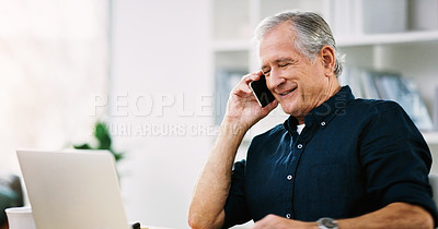Buy stock photo Shot of a cheerful mature businessman answering a phone call in his office