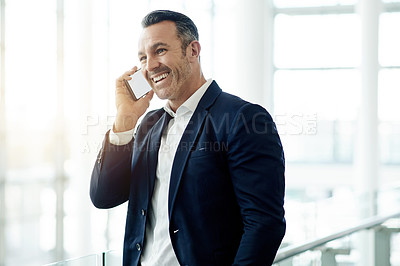 Buy stock photo Shot of a mature businessman talking on a cellphone in an office