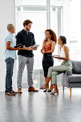 Buy stock photo Full length shot of a group of young businesspeople having a discussion in their office