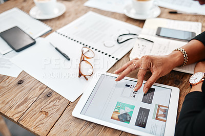 Buy stock photo Cropped shot of a businesswoman using a laptop a modern office