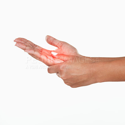 Buy stock photo Studio shot of an unrecognizable woman holding her hand in pain against a white background