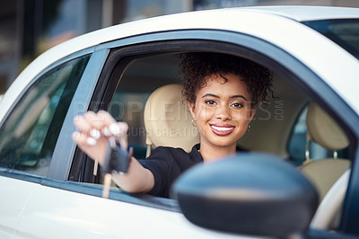 Buy stock photo Cropped portrait of an attractive young woman holding up her car keys while sitting in her new car