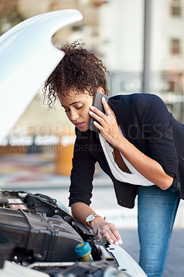 Buy stock photo Cropped shot of an attractive young businesswoman calling roadside assistance after her car broke down
