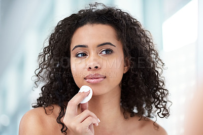 Buy stock photo Shot of a beautiful young woman cleaning her face with cotton wool