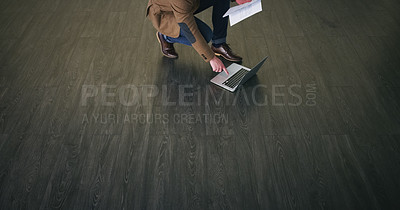 Buy stock photo High angle shot of an unrecognizable businessman using his laptop on the floor