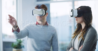 Buy stock photo Cropped shot of two unrecognizable businesspeople trying out virtual reality headsets inside of the office at work