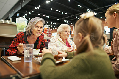 Buy stock photo Cropped shot of a family having lunch at a cafe