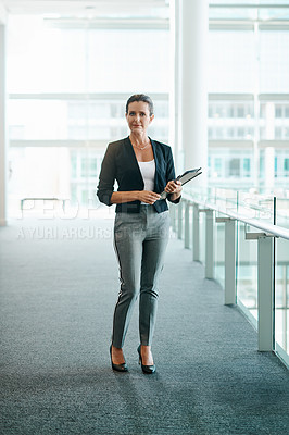 Buy stock photo Portrait of a beautiful businesswoman standing in an office