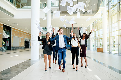 Buy stock photo Shot of a group of cheerful  corporate business colleagues walking through a convention center