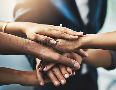 Buy stock photo Cropped shot of a group of businesspeople stacking their hands in an office