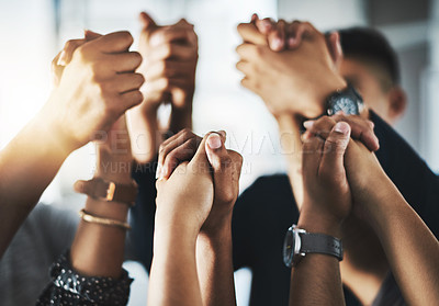 Buy stock photo Cropped shot of a group of unrecognizable businesspeople holding hands