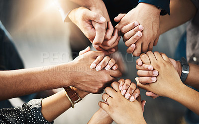 Buy stock photo Shot of a group of unrecognizable people holding hands