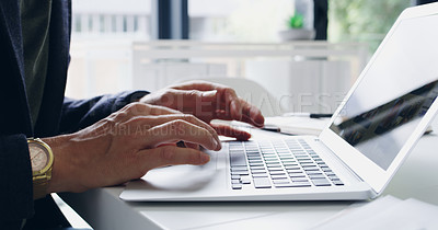 Buy stock photo Closeup shot of an unrecognizable businessman working on a laptop in an office