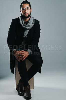 Buy stock photo Studio shot of a handsome and stylish young man posing against a grey background