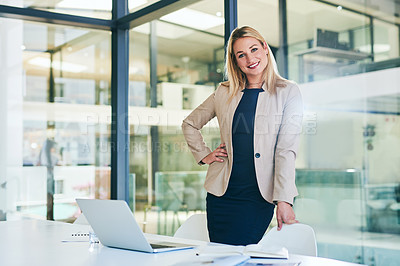 Buy stock photo Cropped portrait of an attractive young businesswoman standing with her hand on her hip in a corporate office