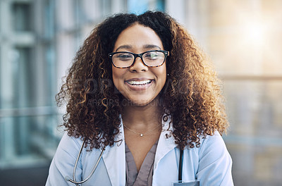 Buy stock photo Portrait of a female doctor standing in a hospital