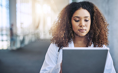 Buy stock photo Shot of a female doctor using a digital tablet