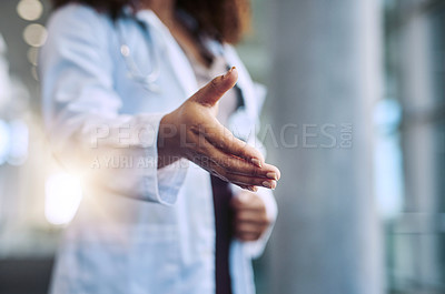 Buy stock photo Cropped shot of a female doctor reaching for a handshake