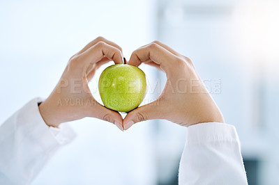 Buy stock photo Closeup shot of an unrecognizable doctor holding an apple