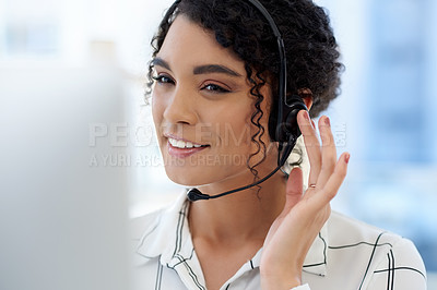 Buy stock photo Cropped shot of an attractive young female customer service representative at work in an office