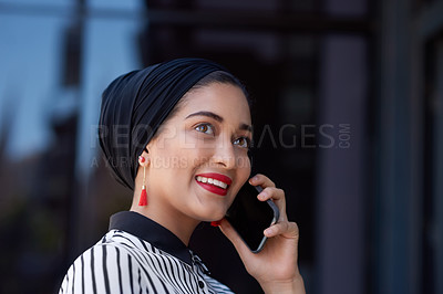 Buy stock photo Shot of a young businesswoman using a smartphone on the balcony of a modern office