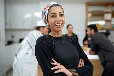 Buy stock photo Portrait of a beautiful young muslim woman at a gathering with friends indoors