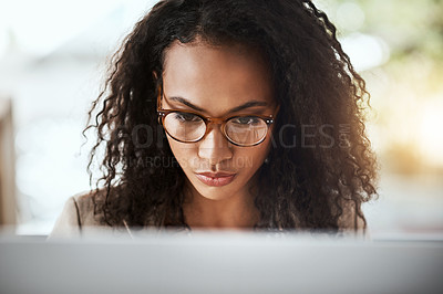 Buy stock photo Cropped shot of a young businesswoman working on her computer
