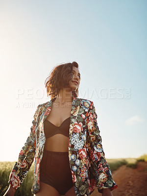 Buy stock photo Shot of a fashionable young woman posing outdoors