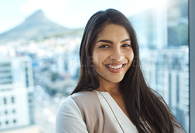 Buy stock photo Portrait of a confident young businesswoman standing in her office