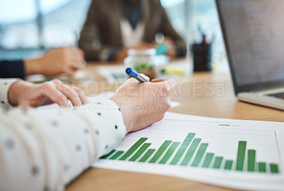 Buy stock photo Shot of unrecognizable businesspeople analyzing graphs in an office