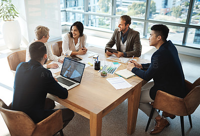 Buy stock photo High angle shot of a diverse group of businesspeople having a meeting in an office