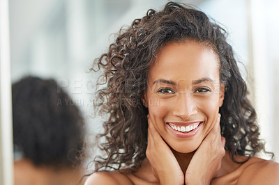 Buy stock photo Shot of an attractive young woman going through her morning beauty routine at home