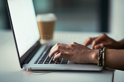 Buy stock photo Cropped shot of a businesswoman using a laptop during a late night at work
