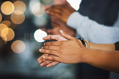 Buy stock photo Cropped shot of a group of unrecognizable businesspeople clapping hands inside of the office at night