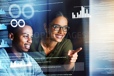 Buy stock photo Cropped shot of two cheerful young businesspeople working on a computer together in the office at night