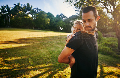 Buy stock photo Cropped shot of an affectionate man piggybacking his daughter at the park
