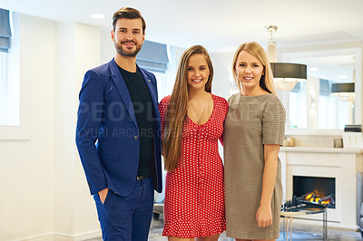 Buy stock photo Portrait of three young businesspeople posing together in an office