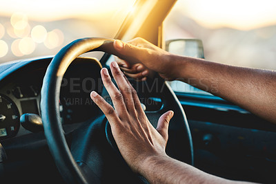 Buy stock photo Cropped shot of an unrecognizable man honking his car horn